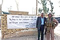 US Navy 071206-M-4746J-016 U.S. Marine Corps Lt. Col. Nathan I. Nastase attached to Personal Security Detail, 3rd Battalion, 3rd Marines poses for a picture with an Iraqi police officer outside a police station.jpg