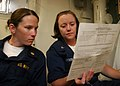 US Navy 080709-N-6764G-142 Lt. Noreen Murphy reviews medical forms with Hospital Corpsman 3rd Class Deanna Gryder aboard the amphibious transport dock ship USS San Antonio (LPD 17).jpg