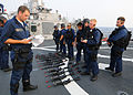US Navy 080721-N-1082Z-032 Members of the visit, board, search, and seizure team, aboard the guided-missile destroyer USS Ramage (DDG 61), prepare to conduct a boarding exercise.jpg