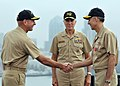 US Navy 081009-N-7981E-233 Rear Adm. Scott Swift shakes hands with Rear Adm. Scott Van Buskirk in front of Vice Adm. Sam Locklear, commander of the U.S. Navy 3rd Fleet, after relieving Van Buskirk as commanding officer.jpg
