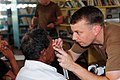 US Navy 081111-N-3173B-033 Lt. Johnny Cosby gives an exam to a local patient at the Mabaruma Library.jpg
