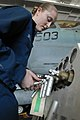 US Navy 081120-N-3610L-070 Aviation Support Equipment Technician 3rd Class Darcy Broom repairs a nitrogen lever on an A-M-26U-4B Nancart.jpg