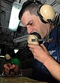 US Navy 081130-N-2456S-073 Aviation Boatswain's Mate (Equipment) 1st Class Tony Pavao ensures all personnel are manned on station.jpg