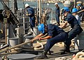 US Navy 081209-N-9134V-026 Sailors heave a mooring line.jpg