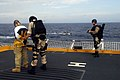 US Navy 090307-N-9610C-062 Damage Controlman 1st Class Jake Wright and Fire Controlman 2nd Class David Leroy apprehend a suspect during a training exercise.jpg