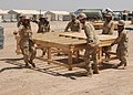 US Navy 090516-N-9410R-041 Seabees assigned to Naval Mobile Construction Battalion (NMCB) 5 move a work platform during the relocation of the Barley Company Pre-Fabrication Yard at Camp Natasha.jpg