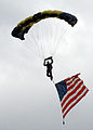US Navy 090530-N-5366K-036 Chief Special Warfare Operator (SEAL) William Davis, assigned to the U.S. Navy Parachute Team, the Leap Frogs, makes his final approach to land at Southern Wisconsin AirFest 2009.jpg