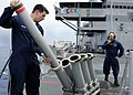 US Navy 090914-N-7478G-164 Intelligence Specialist 1st Class Michael Pukansky, assigned to the amphibious command ship USS Blue Ridge (LCC 19), loads the super rapid blooming offboard chaff launcher.jpg