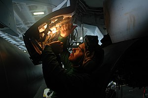 Aviation structural mechanic - Aviation structural mechanic performing maintenance on an EA-6B Prowler