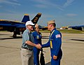US Navy 100516-N-8732C-274 Secretary of the Navy Ray Mabus congratulates Cmdr. Greg McWherter for a job well done, following the Blue Angels' six performances during the 2010 Joint Service Open House Air Show at Joint Base Andr.jpg