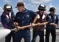 US Navy 100902-N-3620B-062 Aviation Boatswain's Mate (Fuels) 1st Class Jeffrey A. Bennett, center, instructs a hose team during a flight deck fire drill aboard the amphibious transport dock ship USS Denver (LPD 9).jpg