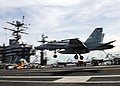 US Navy 101006-N-4973M-047 A F-A-18C Hornet assigned to the Vigilantes of Strike Fighter Squadron (VFA) 151 lands on the flight deck of the aircraf.jpg