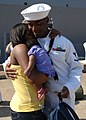 US Navy 110727-N-YF783-050 Intelligence Specialist 3rd Class Gregory Charles hugs his fiance and one-month-old daughter for the first time after re.jpg