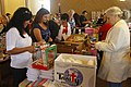 US Navy 111126-N-RC734-007 Volunteers stuff stockings and fill care packages for Sailors and marines deployed overseas as part of an outreach suppo.jpg