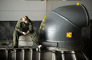 US Navy 111211-N-PB383-232 A Sailor conducts maintenance on the bow of a thruster of a landing craft.jpg