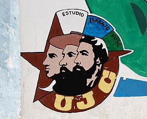 Julio Antonio Mella - Young Communist League (UJC) logo on a wall in Havana. It shows (from left to right) the stylized faces of Julio Mella, Camilo Cienfuegos and Che Guevara.