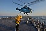 Ukrainian Navy Ka-27 Helix helicopter flies away from the USS Ross.jpg