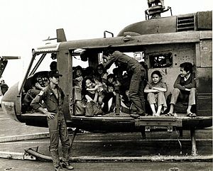 VNAF Huey full with evacuees.jpg