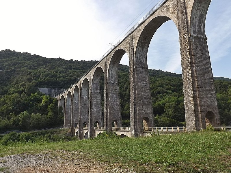 Sight of the Cize-Bolozon viaduc, from the road passing below the railway tracks to cross the river Ain, in Ain, France.