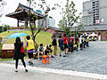 Visitors Buying Tickets Line in Plaza 20140705c.jpg