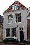 foto van Huis met geverfde langsgevel