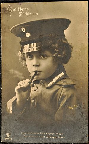 "Youth smoking - A German postcard from the first World War claims that ""He is verily not a brave man, if he cannot stand tobacco."""