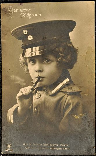 """Youth smoking - A German postcard from the first World War claims that """"He is verily not a brave man, if he cannot stand tobacco."""""""