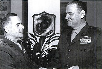 Wallace M. Greene - Commandant Wallace M. Greene congratulates Deputy Chief of Staff for Plans and Programs, Henry W. Buse Jr. on his promotion to lieutenant general on December 30, 1964.