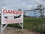 Warning Sign at Maho Beach with Airport (6543967275).jpg