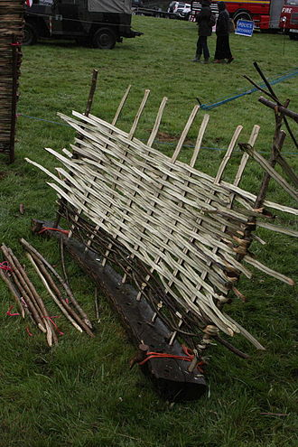 Wattle (construction) - A wattle hurdle being made.