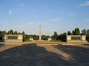 Soviet Military Cemetery, Warsaw - Cemetery's main passage. The soldiers' mass graves lie to either side of the obelisk .