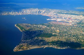 Aerial view of Alki Point in Seattle. Elliott Bay and Downtown Seattle can be seen in the background.