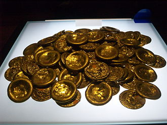 Economy of the Han dynasty - Western Han dynasty (202 BC - 9 AD) gold discs (also called cake-shaped gold), Shaanxi History Museum; excavated from Dongshilipu village, Tanjia town, Weiyang District, Xi'an City, Shaanxi; altogether there are 219 discs, each weighing 227.6-254.4g, their numbers being the biggest among the unearthed gold discs of the Han dynasty. Most of them bear characters, marks, stamps or impressions. They were not meant for circulation as currency, and were mainly used as rewards and gifts.