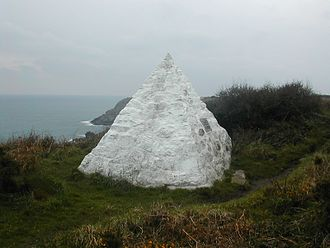 Porthcurno - The white pyramid which replaced a clifftop hut at which the submarine telegraph cable from Brest in France was terminated