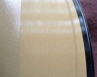 Twelve-inch single - Close-up shot of a 12-inch (30 cm) single showing the wide grooves