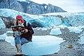 Woman sitting on ice floe on Svalbard.jpg