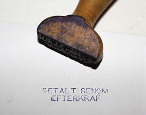 "Rubber stamp - Example of stamp carved from wood, approximately 1940s. Swedish text. English: ""Paid by collect on delivery""."