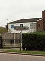 Woodchurch sign at Arrowe Brook Road.jpg