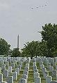 World War II era planes fly over Washington, D.C. seen from Arlington National Cemetery (17243976308).jpg