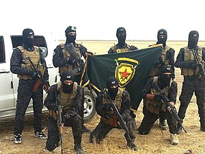 Anti-Terror Units - YAT fighters with the unit's flag in late 2015.