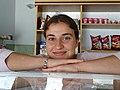 Young Woman behind Cafe Counter - Delvina - Albania (41623330854).jpg