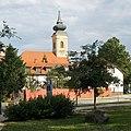'Széchenyi István Egyetem' bus stop and Holy Trinity Church, 2018 Győr.jpg