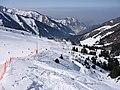 Вид из открытой кабины канатной дороги на горнолыжную трассу курорта Чимбулак.JPG