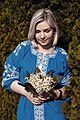 День Вишиванки. Молода україночка у вишитій синій сукні серед квітів 14.jpg