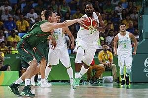 Jonas Mačiulis - Mačiulis attempting a steal from Nenê during the 2016 Summer Olympics in Brazil.