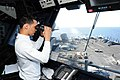 141010-N-CZ979-003 Aviation Boatswain's Mate 3rd Class Matthew Reyes observes flight operations from primary flight control aboard the USS George H.W. Bush.JPG