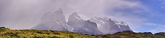 "Cordillera Paine - The Paine ""horns,"" with the typical extreme weather of the region"