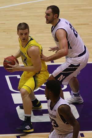 2014–15 Michigan Wolverines men's basketball team - Andrew Dakich (left) almost redshirted and Max Bielfeldt (right) reclassified.