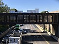 2018-10-23 12 53 49 View west along the eastbound lanes of Interstate 66 and the Orange Line of the Washington Metro from the overpass for Gallows Road (Virginia State Route 650) on the border of Merrifield and Dunn Loring in Fairfax County, Virginia.jpg