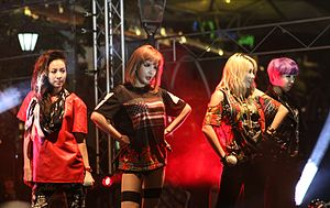K-pop - 2NE1 holding a concert in Clarke Quay, Singapore.